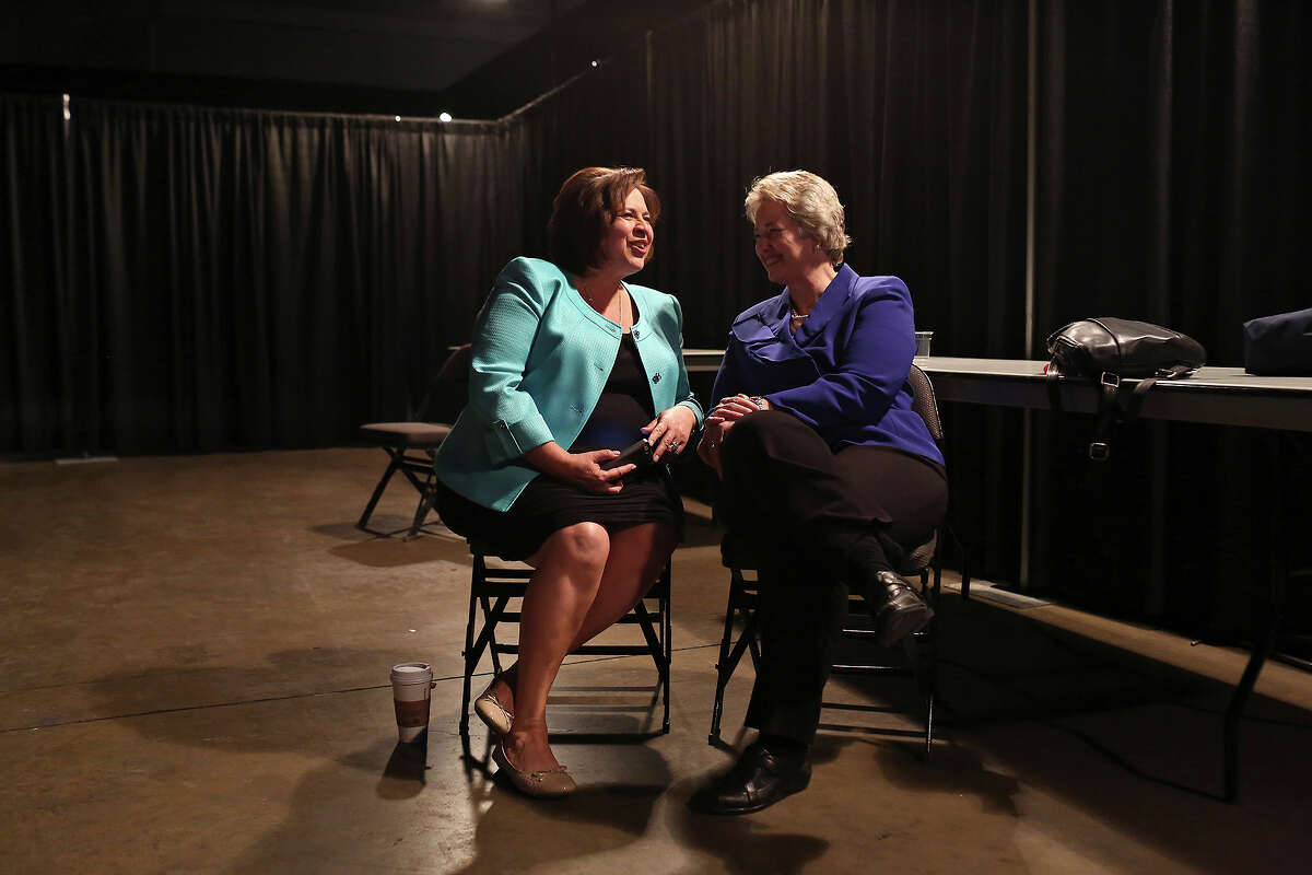 Leticia Van de Putte, State Senator and candidate for Lt. Governor, talks with Annise D. Parker, Mayor of Houston, backstage as they wait to speak to the Stonewall Democrats Caucus during the Texas Democratic State Convention at the Dallas Convention Center in Dallas on Friday, June 27, 2014.