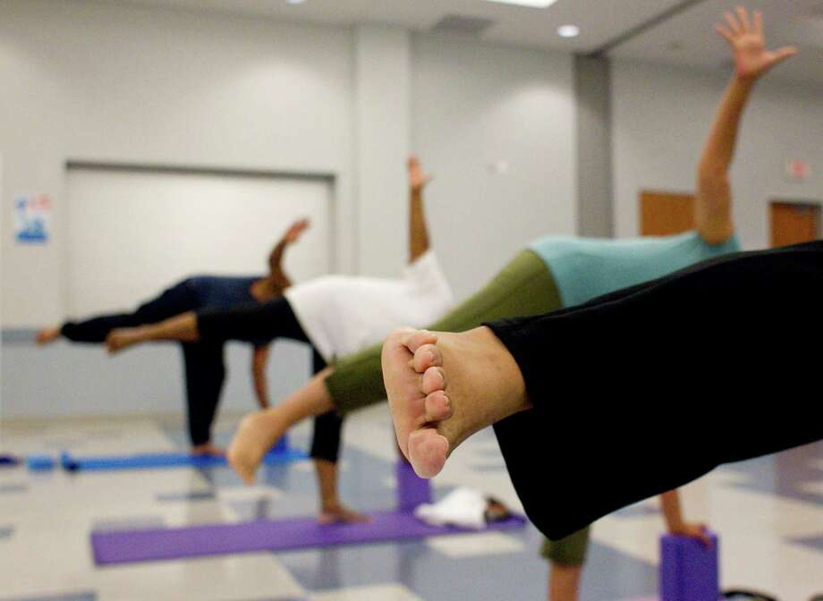 Houston Public Library offers free yoga classes. Photo: Johnny Hanson, Houston Chronicle / Houston Chronicle