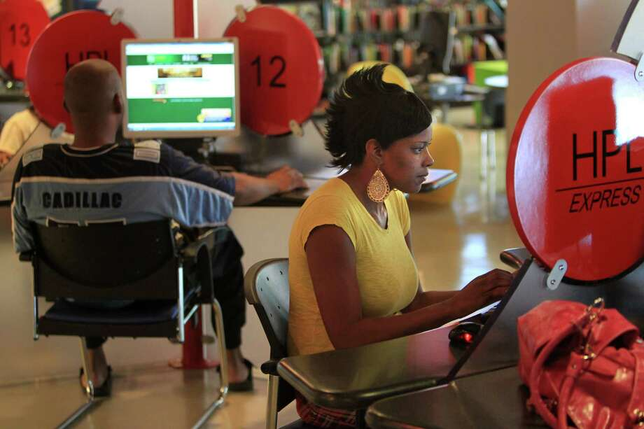 In southwest Houston, at the Morris Frank Branch Library, patrons often use library resources to search for jobs. Photo: Mayra Beltran, Chronicle / Houston Chronicle
