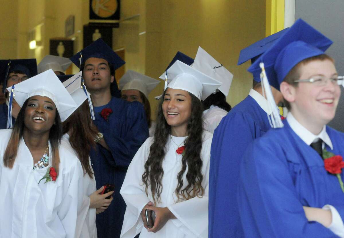 Shaker High School graduates are all smiles as they line up for procession during their graduation ceremony at the SEFCU Arena on Saturday June 28, 2014 in Albany, N.Y. (Michael P. Farrell/Times Union)