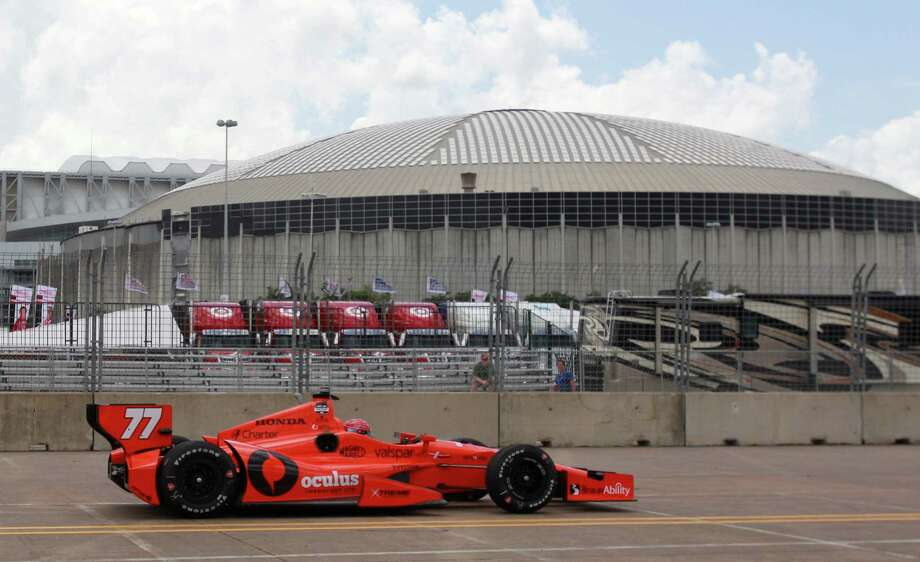 NRG Astrodome is shown in the background as IndyCar driver Simon Pagenaud makes a lap during an IndyCar practice session for the Grand Prix of Houston at NRG Park Friday, June 27, 2014, in Houston. He had the fastest lap during the practice. Photo: Melissa Phillip, Houston Chronicle / © 2014  Houston Chronicle