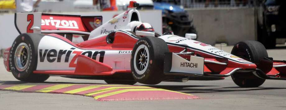 IndyCar driver Juan Pablo Montoya makes his way through Turn 2 during an IndyCar practice session for the Grand Prix of Houston at NRG Park Friday, June 27, 2014, in Houston. Photo: Melissa Phillip, Houston Chronicle / © 2014  Houston Chronicle