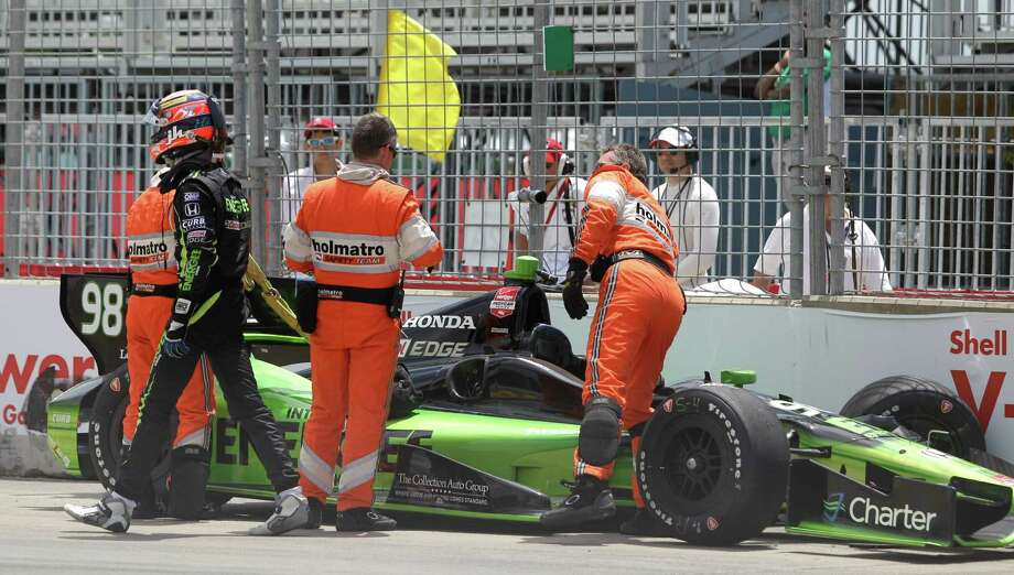 IndyCar driver Jack Hawksworth walks away from a crash near Turn 2 during an IndyCar practice session for the Grand Prix of Houston at NRG Park Friday, June 27, 2014, in Houston. Photo: Melissa Phillip, Houston Chronicle / © 2014  Houston Chronicle