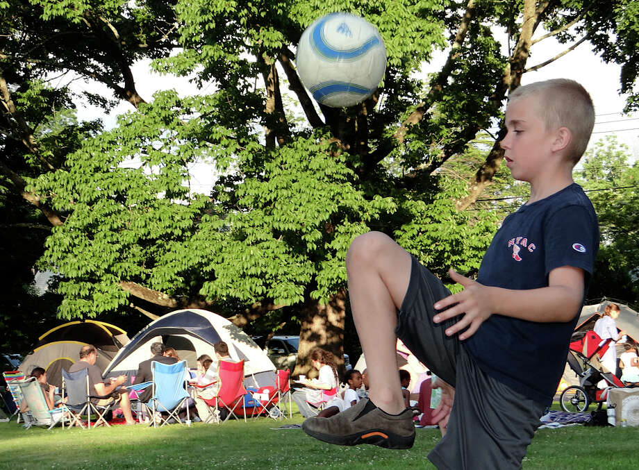 Tate Theodorsen, 10, of Fairfield, demonstrates his soccer skills Friday at the Pequot Library's community potluck dinner and campout. Photo: Mike Lauterborn / Fairfield Citizen