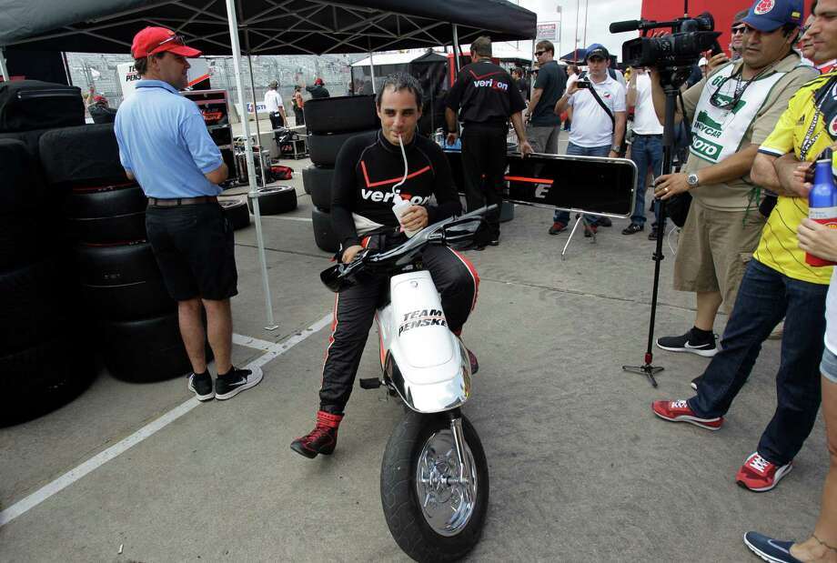 IndyCar driver Juan Pablo Montoya leaves from the pit area after an IndyCar qualifying session for the Grand Prix of Houston at NRG Park Saturday, June 28, 2014, in Houston. Photo: Melissa Phillip, Houston Chronicle / © 2014  Houston Chronicle