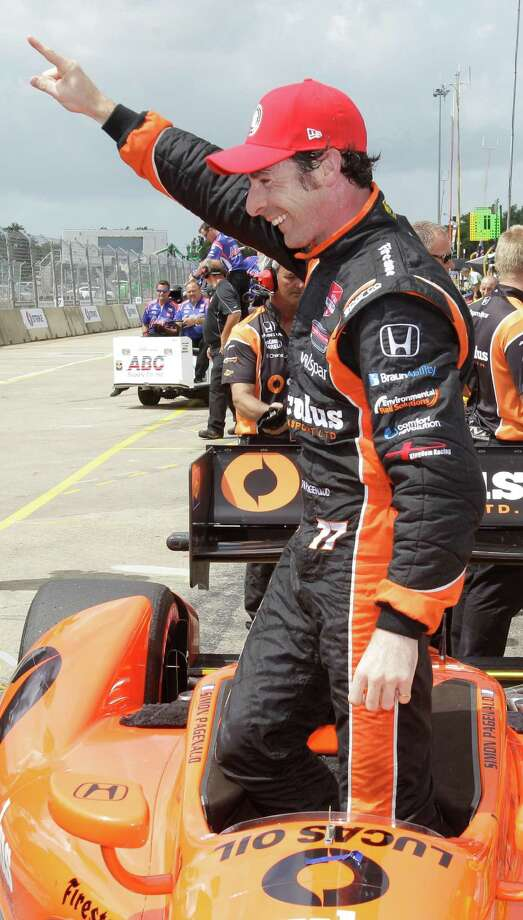 IndyCar driver Simon Pagenaud poses for photographers after winning the pole position during IndyCar qualifying session for the Grand Prix of Houston at NRG Park Saturday, June 28, 2014, in Houston. Photo: Melissa Phillip, Houston Chronicle / © 2014  Houston Chronicle