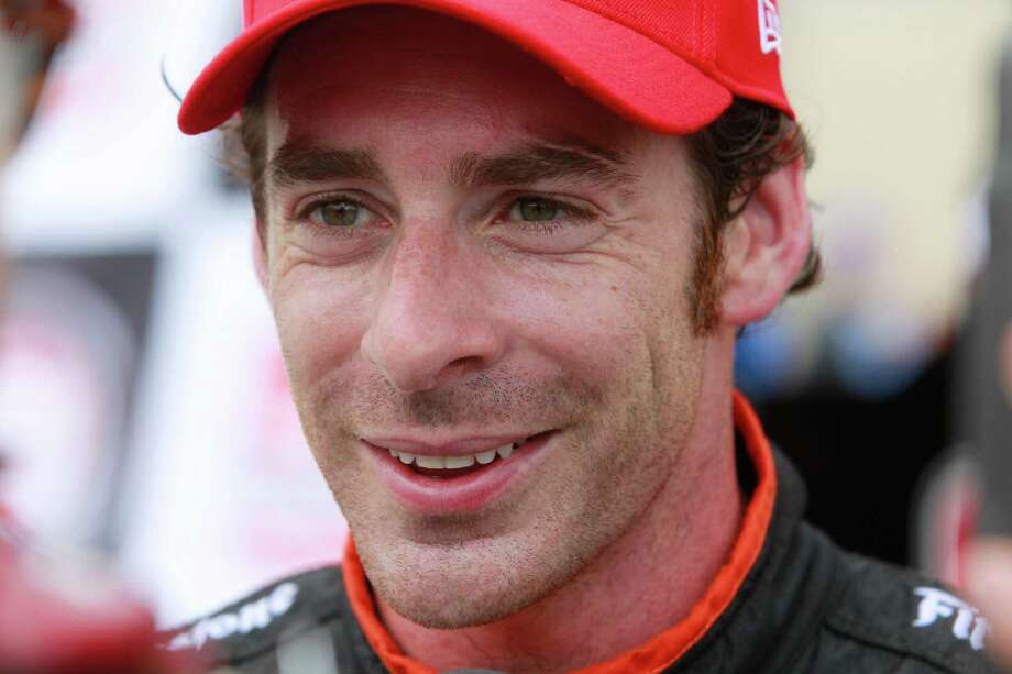 IndyCar driver Simon Pagenaud talks to the media after winning the pole position during IndyCar qualifying session for the Grand Prix of Houston at NRG Park Saturday, June 28, 2014, in Houston. Photo: Melissa Phillip, Houston Chronicle / © 2014  Houston Chronicle