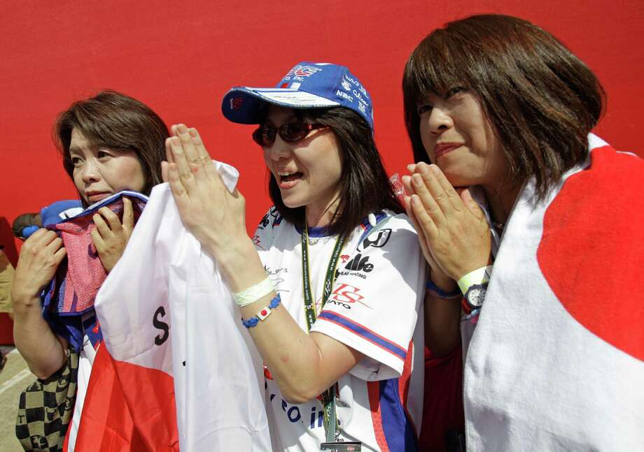 Sumiko Yamanashi, left, Sone Setsuko, and Sachiko Wada, right, all from Tokyo, Japan watch monitor and cheer for IndyCar driver Takuma Sato during an IndyCar qualifying session for the Grand Prix of Houston at NRG Park Saturday, June 28, 2014, in Houston. Photo: Melissa Phillip, Houston Chronicle / © 2014  Houston Chronicle