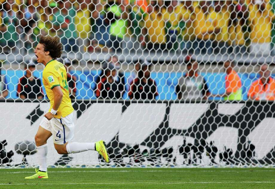 Brazil's David Luiz celebrates after scoring a penalty during the World Cup round of 16 soccer match between Brazil and Chile at the Mineirao Stadium in Belo Horizonte, Brazil, Saturday, June 28, 2014. Brazil won 3-2 on penalties .(AP Photo/Frank Augstein) Photo: Frank Augstein, Associated Press / AP