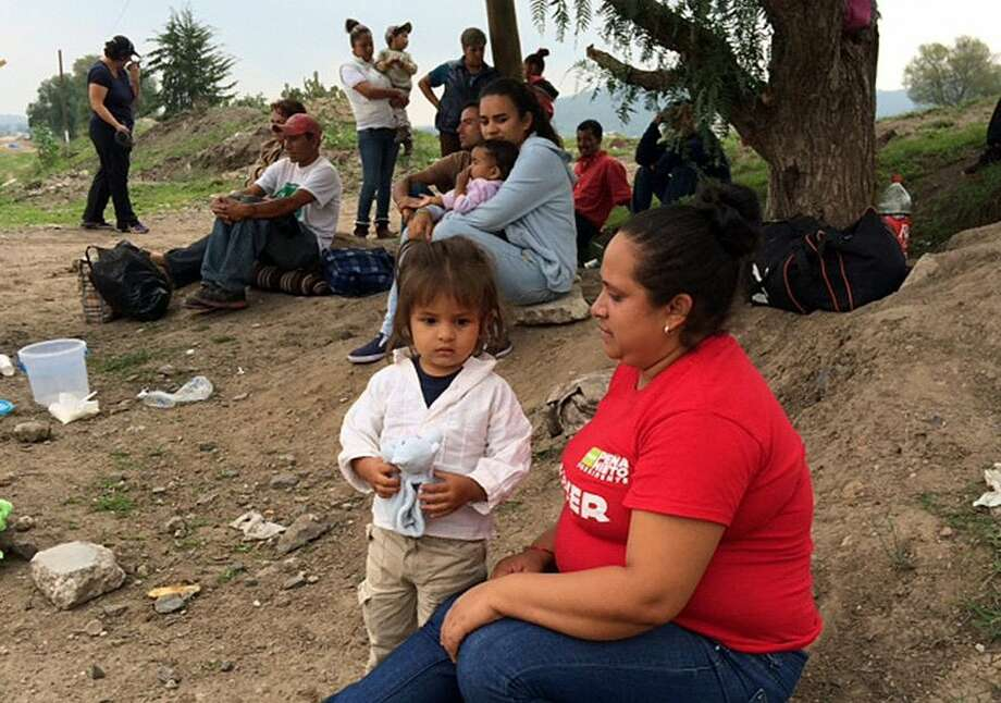 "Children and parents who traveled from Honduras, mostly, wait in Tequixquiac, Mexico, for the train known as ""The Beast"" that will take them to the United States border. Photo: Tracy Wilkinson, MBR / Los Angeles Times"