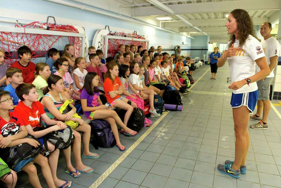 Olympic silver medalist Kristy Kowal talks to swimmers at Chelsea Piers Connecticut during the Mutual of Omaha Breakout Swim Clinic hosted by The Wolverines swim clubâÄôs Train with a Champ Weekend Camp in Stamford, Conn., on Saturday, June 28, 2014. Olympic gold medalist Misty Hyman and four-time gold medalist Jason Lezak also participated in the program. Photo: Lindsay Perry / Stamford Advocate