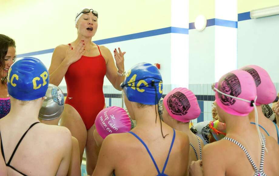 Olympic gold medalist Misty Hyman talks to swimmers at Chelsea Piers Connecticut during the Mutual of Omaha Breakout Swim Clinic hosted by The Wolverines swim clubâÄôs Train with a Champ Weekend Camp in Stamford, Conn., on Saturday, June 28, 2014. Olympic silver medalist Kristy Kowal and four-time gold medalist Jason Lezak also participated in the program. Photo: Lindsay Perry / Stamford Advocate