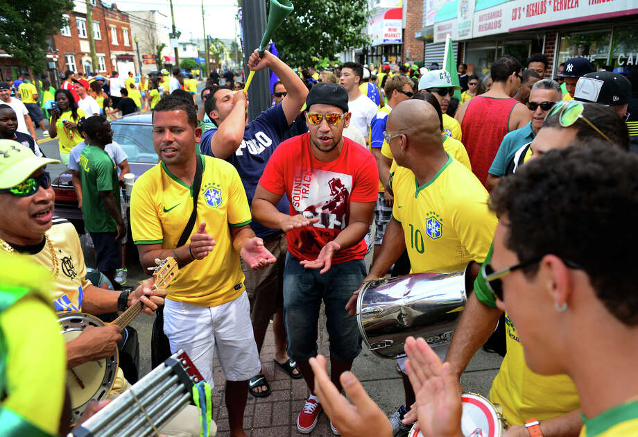 Bridgeport's Brazilian residents plays instruments and sing on Madison Avenue to celebrate its soccer team's win over Chile in World Cup Soccer on Saturday June 28, 2014. Hundreds of fans spilled onto the street causing police to close an entire block. Photo: Christian Abraham / Connecticut Post