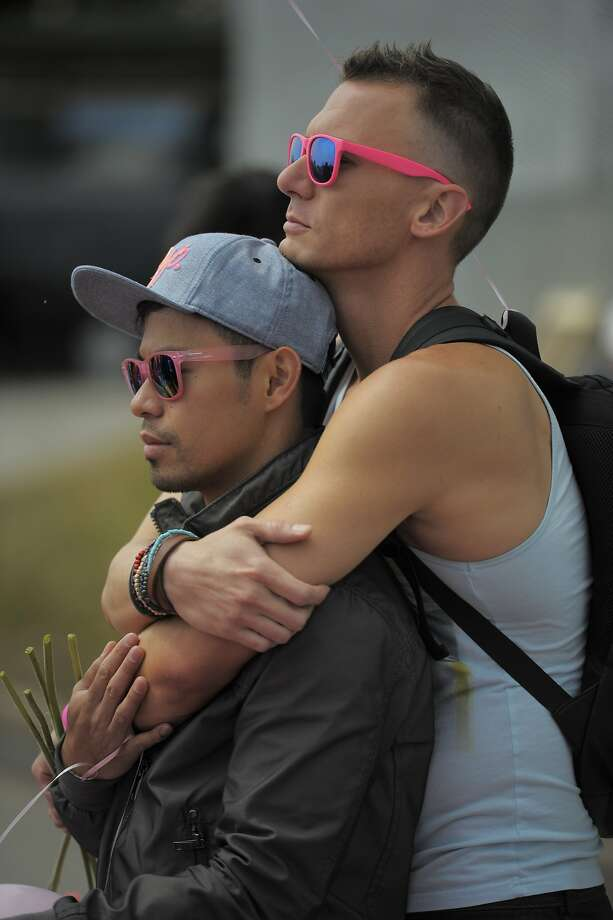 Chris Hanner embraces Robert Rimando during a ceremony commemorating the construction of the pink triangle at Twin Peakson June 28, 2014 in San Francisco, CA. The Pink Triangle, symbol of the oppression of LGBT people, was built on Twin Peaks Saturday in recognition of the pride celebration. Photo: Craig Hudson, The Chronicle