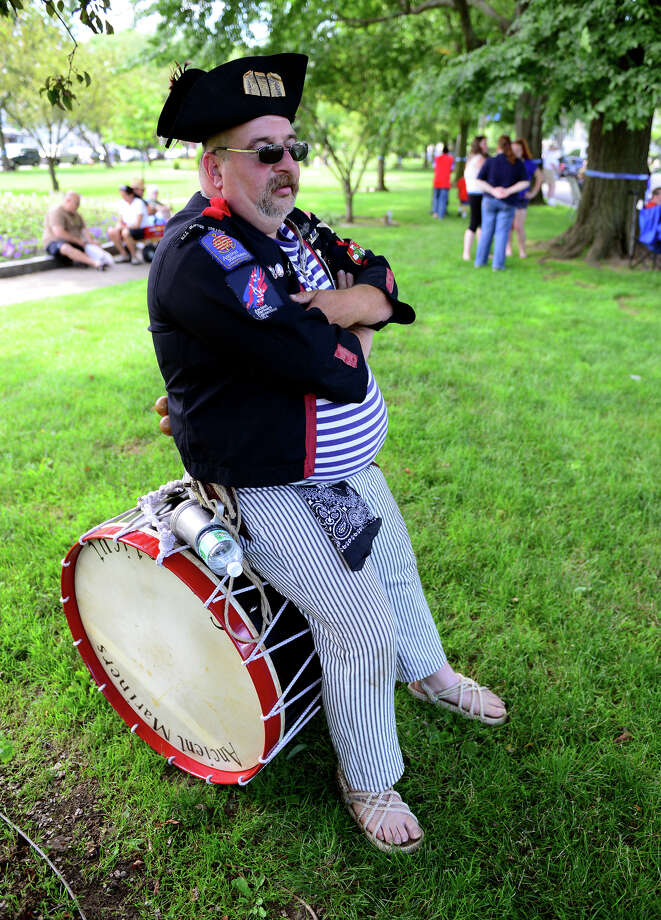 Scott Stedman, of South Glastonbury, waits to muster with his group: the Ancient Mariners, out of Guilford, before the start of the Milford Volunteers Ancient Fife & Drum Corps 50th Anniversary Muster and Parade, held along Broad Street at the historic Milford Green in downtown Milford on Saturday June 28, 2014. The event coincides with the 375th anniversary celebrations for the founding of Milford going on throughout the summer. Photo: Christian Abraham / Connecticut Post