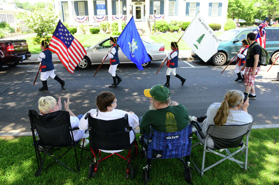 The Milford Volunteers Ancient Fife & Drum Corps held its 50th Anniversary Muster and Parade along Broad Street along the historic Milford Green in downtown Milford on Saturday June 28, 2014. The event coincides with the 375th anniversary celebrations for the founding of Milford going on throughout the summer. Photo: Christian Abraham / Connecticut Post