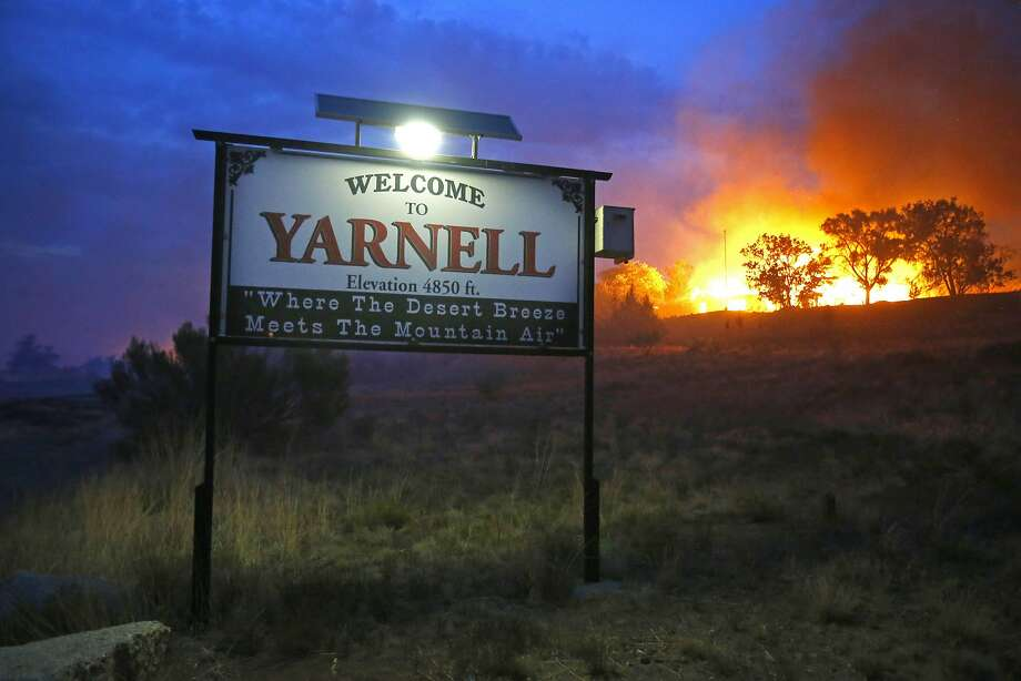 Flames are seen last year from the Yarnell Hill Fire, where 19 firefighters were killed. Despite two investigations, there have been few changes in the system. Photo: David Kadlubowski, Associated Press