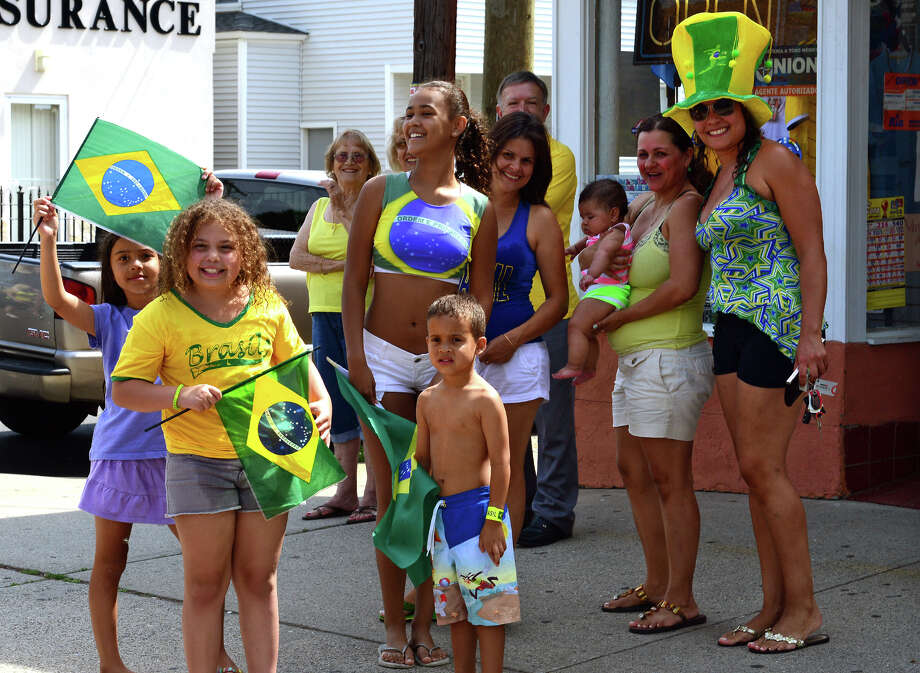 Bridgeport's Brazilian residents celebrate its soccer team's win over Chile in World Cup Soccer on Saturday June 28, 2014. Hundreds of fans spilled onto the street causing police to close an entire block. Photo: Christian Abraham / Connecticut Post