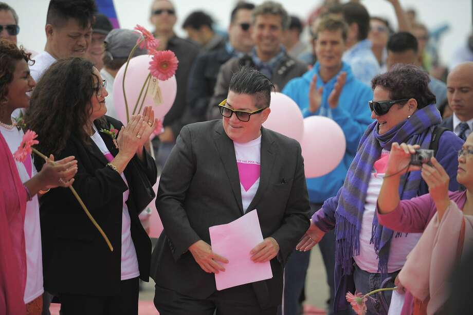Comedian and actor Lea Delaria approaches the stage to speak during a ceremony commemorating the construction of the pink triangle at Twin Peaks on June 28, 2014 in San Francisco, CA. The Pink Triangle, symbol of the oppression of LGBT people, was built on Twin Peaks Saturday in recognition of the pride celebration. Photo: Craig Hudson, The Chronicle