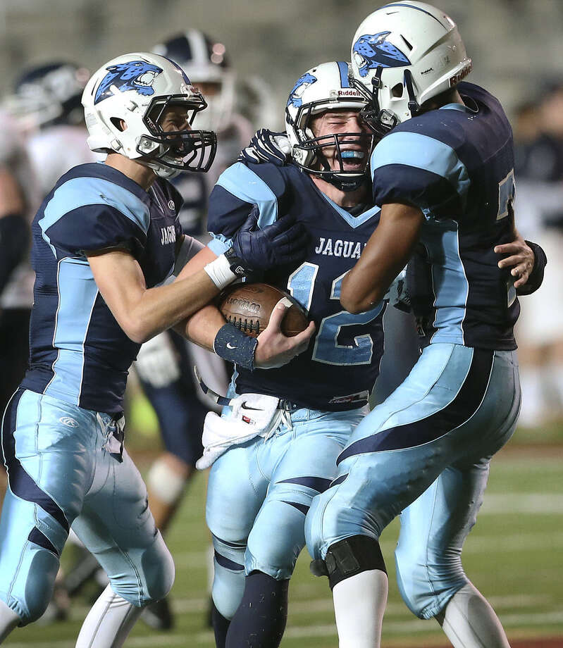 Coleman Fowler (from left), Hunter Rittimann and Darion McElhannon celebrate a TD during Johnson's bidistrict upset of Smithson Valley. Photo: Tom Reel / San Antonio Express-News / San Antonio Express-News