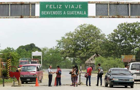 Young travelers cross the border into Guatemals at Corinto, Honduras, however the one in the red shirt at right, Luis Hernandez, was turned away for being underage. Friday, June 27, 2014. Photo: Bob Owen, San Antonio Express-News / ©2013 San Antonio Express-News