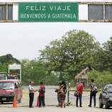 Young travelers cross the border into Guatemals at Corinto, Honduras, however the one in the red shirt at right, Luis Hernandez, was turned away for being underage. Friday, June 27, 2014.