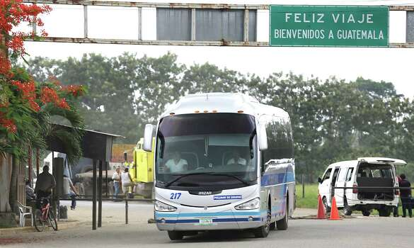 A Mexican bus full of deported Honduran families with children crosses the Guatemalan border at Corinto, Honduras, taking them back to the Family and Children Shelter in San Pedro Sula. Friday, June 27, 2014. Photo: Bob Owen, San Antonio Express-News / ©2013 San Antonio Express-News