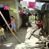 A small boy chops wood for his family with a machete almost as big as him, at his home in Corinto, Honduras at the Guatemala border, where hidden crossing spots are heavily used by guides or coyotes in human trafficking. Friday, June 27, 2014.