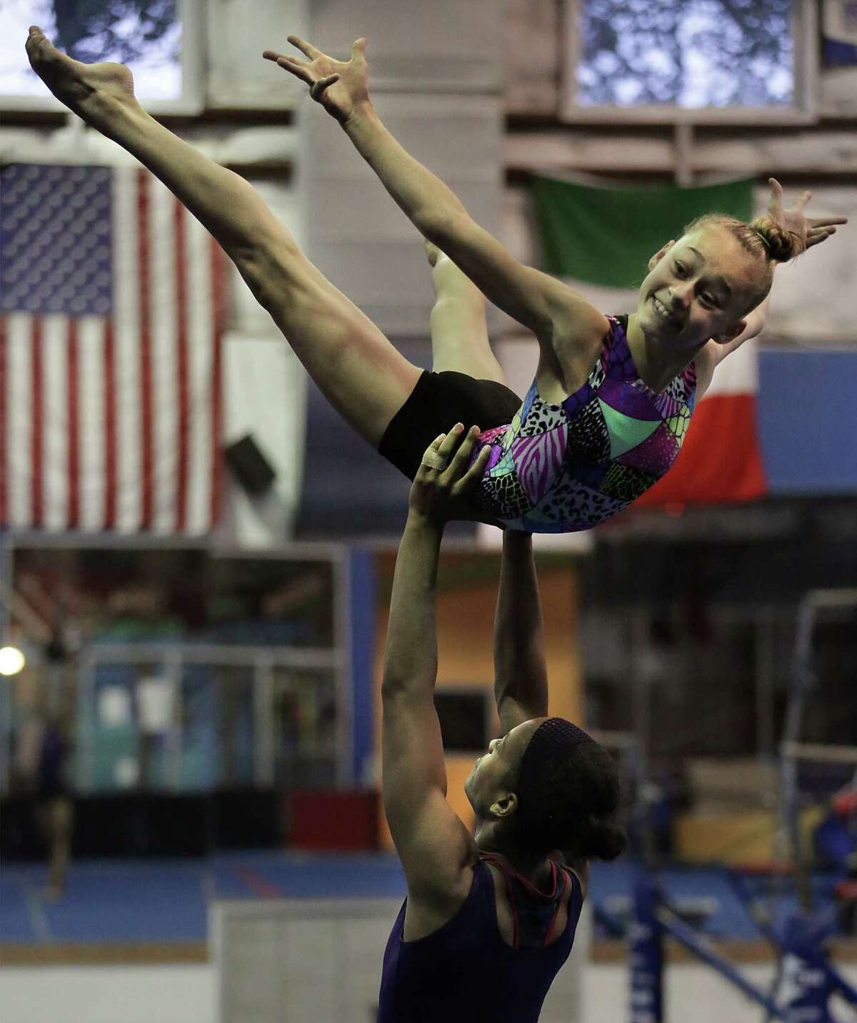 Jessica Renteria lifts Maren Merwarth as they practice their routine at Acrobatic Gymnastics of San Antonio. A team of young gymnasts will travel to Paris, France to compete in the Acrobatic Gymnastics World Championships. Friday, June 20, 2014.
