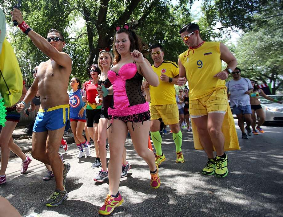 Runner start the two mile Hot Undies Run on June 28, 2014, in Houston, Tx. The Hot Undies Run charity event started at the Gorgeous Gael Pub in Rice Village. ( Mayra Beltran / Houston Chronicle ) Photo: Houston Chronicle