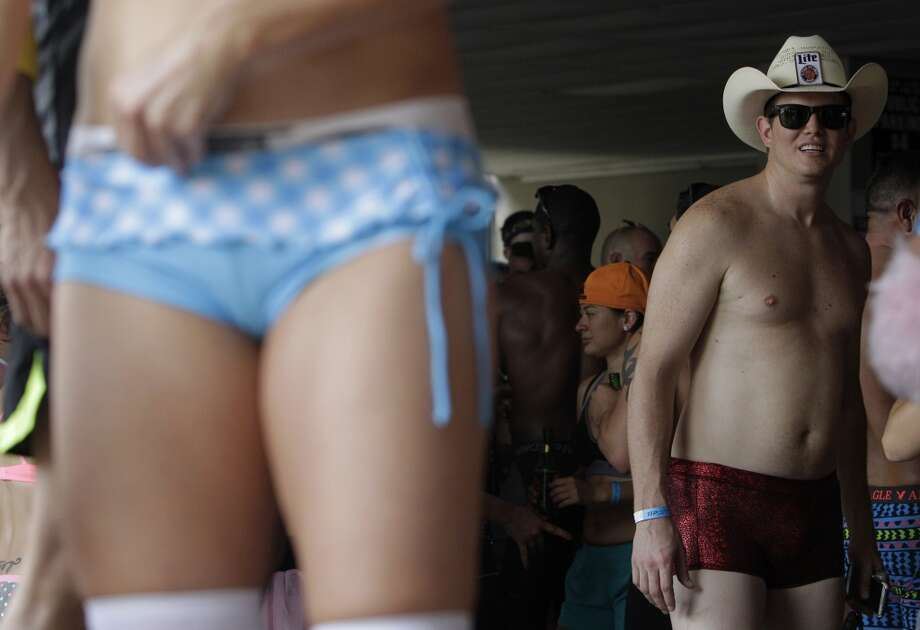Matt Nicholls checks out the view while dancing during the pre-party to the Hot Undies Run on June 28, 2014, in Houston, Tx. The Hot Undies Run charity event started at the Gorgeous Gael Pub in Rice Village. ( Mayra Beltran / Houston Chronicle ) Photo: Houston Chronicle
