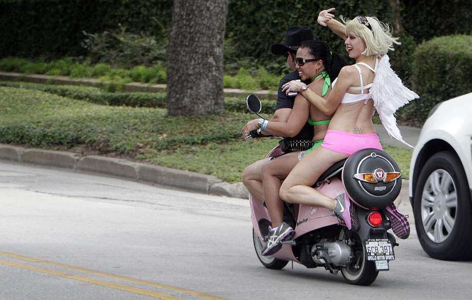 Bernadette Lord and friends hitch a ride back to the finish line during the Hot Undies Run on June 28, 2014, in Houston, Tx. The Hot Undies Run charity event started at the Gorgeous Gael Pub in Rice Village. ( Mayra Beltran / Houston Chronicle ) Photo: Houston Chronicle