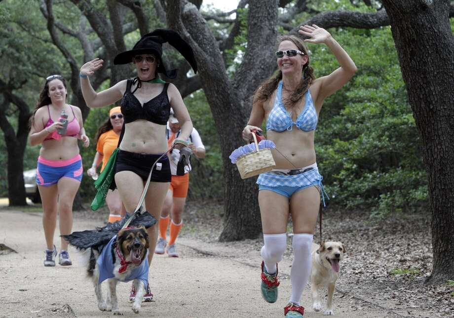 Heather Dunn, the Wizard of Oz witch, and Sheri Davidson, as Dorothy, run toward the finish line along Rice Blvd. during the Hot Undies Run on June 28, 2014, in Houston, Tx. The Hot Undies Run charity event started at the Gorgeous Gael Pub in Rice Village. ( Mayra Beltran / Houston Chronicle ) Photo: Houston Chronicle