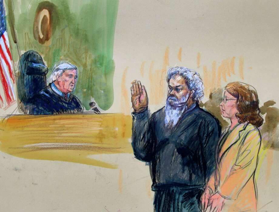 Judge John Facciola swears in the defendant, Libyan militant Ahmed Abu Khattala, on Saturday. Khattala's prosecution in U.S. courts is the latest in a series of terror cases that have stirred a debate among U.S. officials. Photo: Jose Luis Magana, FRE / FR159526 AP