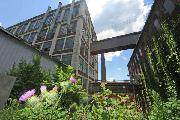 Mostly abandoned mill space along Willow Street on Friday June 26, 2014 in Amsterdam, N.Y. (Michael P. Farrell/Times Union)