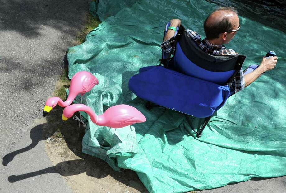 Lou Sirianni of the Adirondacks sits with a cold beverage and two lawn flamingo as he listens to music during the 2014 Freihofer's Saratoga Jazz Festival  on Saturday June 28, 2014 in Saratoga Springs, N.Y. (Michael P. Farrell/Times Union) Photo: Michael P. Farrell / 00027434A