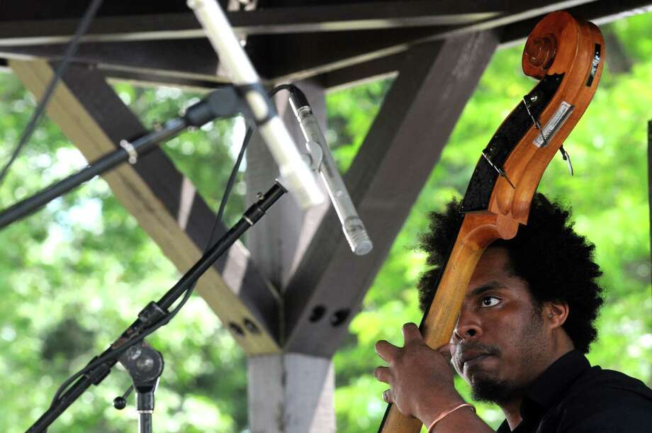 Rashaan Carter on bass with the Marc Cary Focus Trio performs on the gazebo stage during the 2014 Freihofer's Saratoga Jazz Festival  on Saturday June 28, 2014 in Saratoga Springs, N.Y. (Michael P. Farrell/Times Union) Photo: Michael P. Farrell / 00027434A