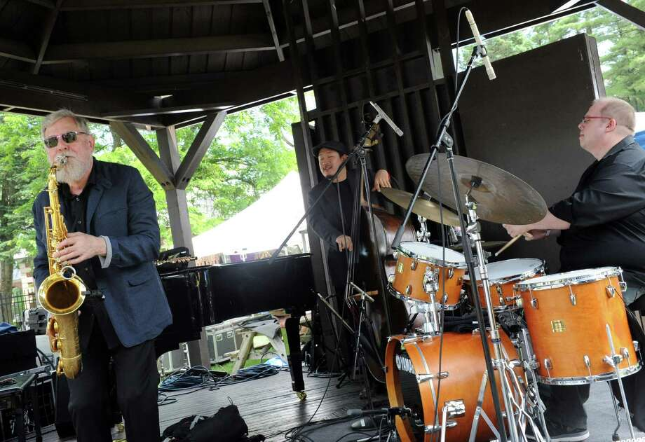 Lew Tabackin, left, with his Trio performs on the gazebo stage during the 2014 Freihofer's Saratoga Jazz Festival  on Saturday June 28, 2014 in Saratoga Springs, N.Y. (Michael P. Farrell/Times Union) Photo: Michael P. Farrell / 00027434A