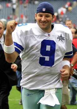 Dallas Cowboys quarterback Tony Romo (9) pumps his fist as he leaves the field after beating the Houston Texans in an NFL football game at Reliant Stadium Sunday, Sept. 26, 2010, in Houston. The Cowboys beat the Texans 27-13. ( Brett Coomer / Houston Chronicle ) Photo: Brett Coomer, HC Staff / Houston Chronicle