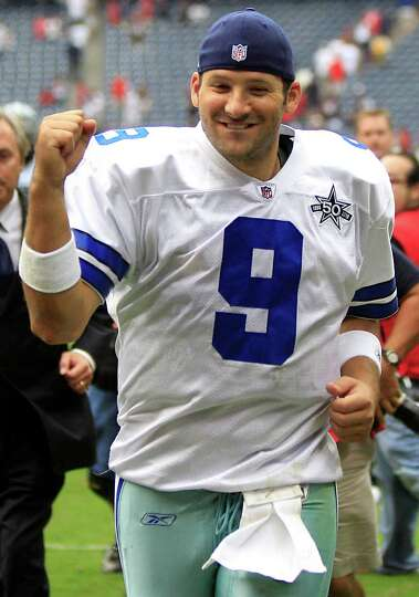 Dallas Cowboys quarterback Tony Romo (9) pumps his fist as he leaves the field after beating the Hou