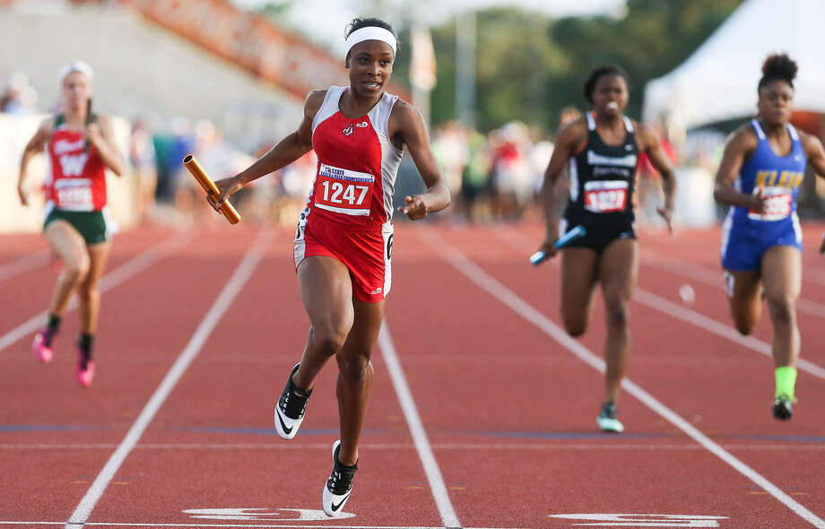 Talajah Murrell crosses the finish line first for Judson in the Class 5A 800-meter relay at the UIL state meet May 10. Murrell is one of eight girls who will be returning to defend the Rockets' state title next season. Photo: Marvin Pfeiffer / San Antonio Express-News / Express-News 2014