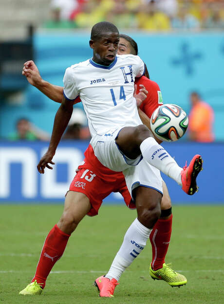 Dynamo midfielder Boniek Garcia (14) played in the World Cup group stage for Honduras, which was eliminated after three losses. Photo: Felipe Dana, STF / AP