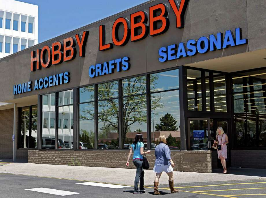 FILE - In this May 22, 2013, customers enter and exit a Hobby Lobby store in Denver. The Supreme Court is poised to deliver its verdict in a case that weighs the religious rights of employers and the right of women to the birth control of their choice. Employers must cover contraception for women at no extra charge among a range of preventive benefits in employee health plans. Dozens of companies, including the arts and crafts chain Hobby Lobby, claim religious objections to covering some or all contraceptives. (AP Photo/Ed Andrieski, File) Photo: Ed Andrieski, STF / AP
