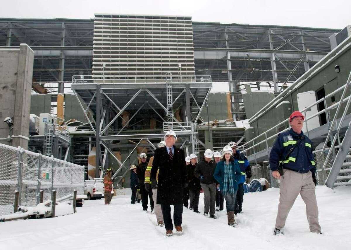 Sen. Christopher Dodd, D-Conn, left, and a group of officials tour the Kleen Energy Plant in Middletown, Conn., on Tuesday, Feb. 16, 2010. Dodd toured the Kleen Energy plant, where five people died in an explosion in Middletown, Conn., on Sunday, Feb. 7, 2010. (AP Photo/Thomas Cain)
