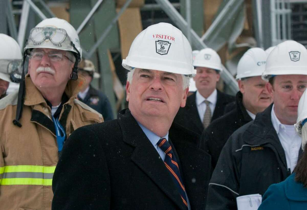 Sen. Christopher Dodd, D-Conn, right, surverys the damage at the Kleen Energy Plant with officials in Middletown, Conn., on Tuesday, Feb. 16, 2010. Dodd toured the plant, where five people died in an explosion in Middletown, Conn., on Sunday, Feb. 7, 2010. (AP Photo/Thomas Cain)