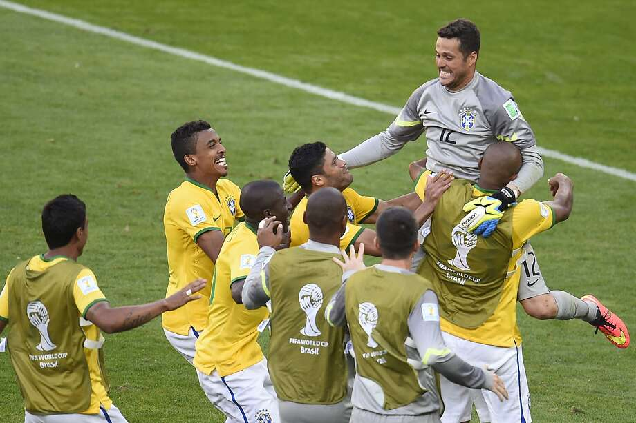 Brazil goalkeeper Julio Cesar gets a hero's welcome after making two saves in the shootout. Photo: Odd Andersen, AFP/Getty Images