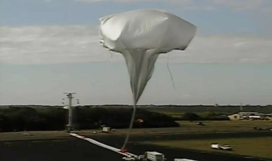This image provided by NASA shows the launch of the high-altitude balloon carrying a saucer-shaped vehicle for NASA, to test technology that could be used to land on Mars, Saturday June 28, 2014 in Kauai, Hawaii. Saturday's experimental flight high in Earth's atmosphere is testing a giant parachute designed to deliver heavier spacecraft and eventually astronauts.  (AP Photo/NASA) Photo: Associated Press