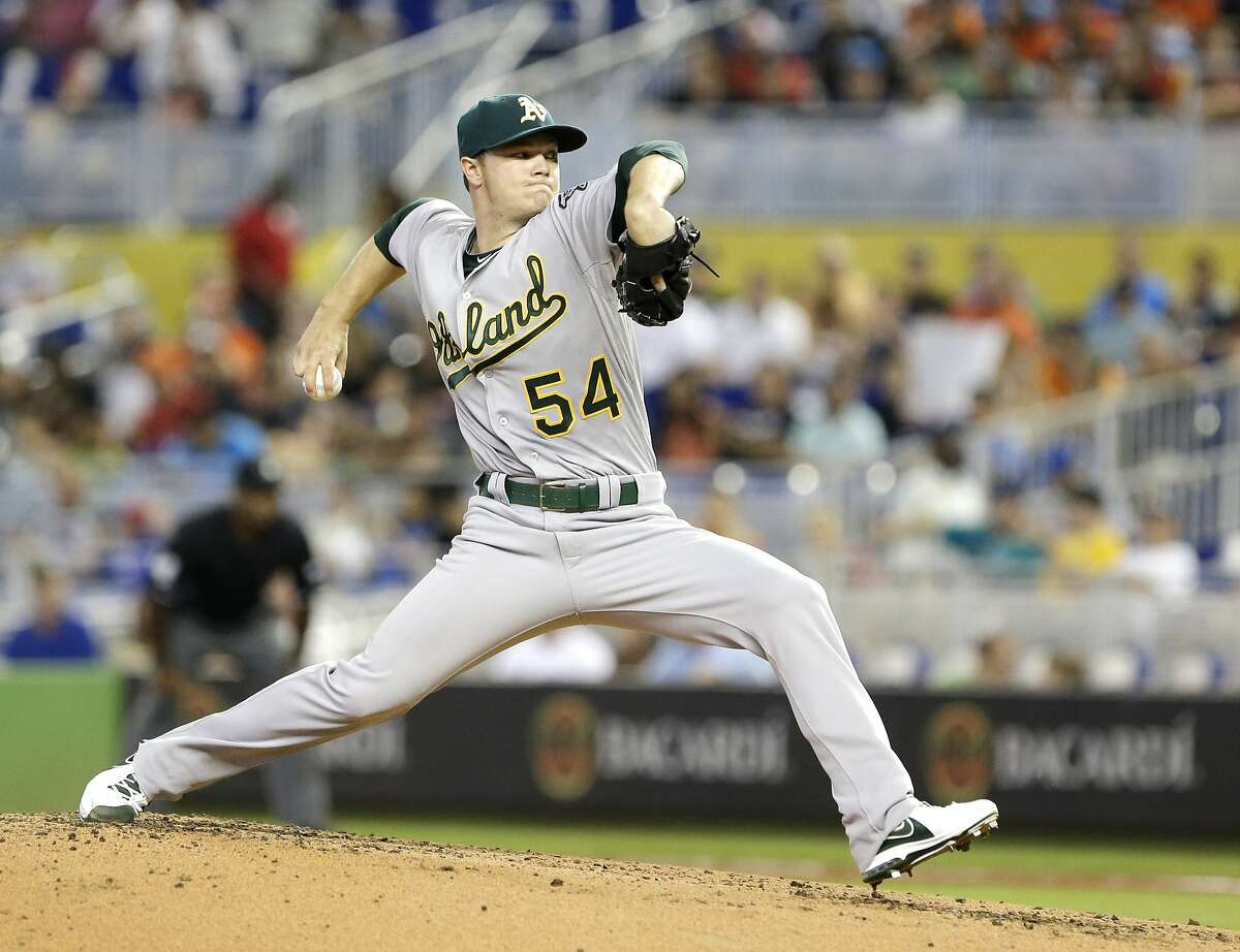 Oakland Athletics' Sonny Gray delivers a pitch during the first inning of a baseball game against the Miami Marlins, Saturday, June 28, 2014 in Miami. (AP Photo/Wilfredo Lee)