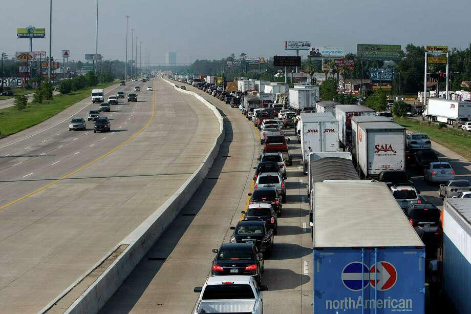 This view from FM 1488 and Interstate 45 in Montgomery County shows southbound traffic blocked by a wreck. Easing traffic flow for commuters is the goal of an HOV lane extension to be completed by fall 2015. Photo: Johnny Hanson, Staff / © 2012  Houston Chronicle