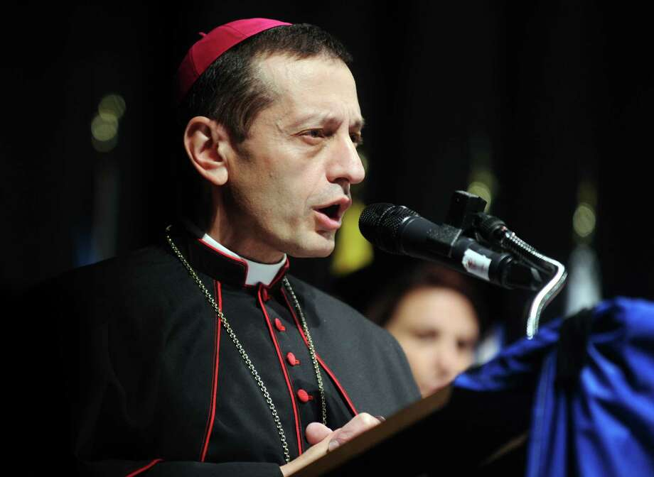 Frank J. Caggiano, Bishop of Bridgeport, speaks during St. Vincent's College's 22nd annual commencement ceremony Friday, May 23, 2014, at the Arnold Bernhard Arts and Humanities Center at the University of Bridgeport. Photo: Autumn Driscoll / Connecticut Post